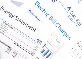 A fanned out stack of utility billing statements.